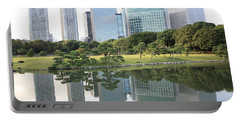 Tokyo Skyline Reflection Portable Battery Charger by Carol Groenen