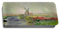 Tulip Field In Holland Portable Battery Charger by Claude Monet