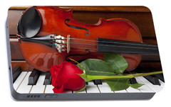 Violin With Rose On Piano Portable Battery Charger by Garry Gay