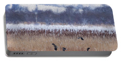 Winter Lapwings Portable Battery Charger by Liz Leyden
