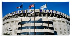 Flags In Front Of A Stadium, Yankee Beach Towel by Panoramic Images