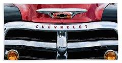 1955 Chevrolet 3100 Pickup Truck Grille Emblem Beach Towel by Jill Reger