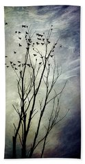 Flock Of Birds In Silhouette Beach Towel by Christina Rollo