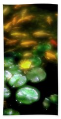 Goldfish Swimming By Lily Pads In Pond Beach Towel by Panoramic Images