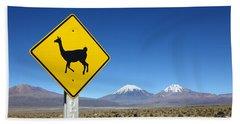 Llamas Crossing Sign Beach Towel by James Brunker