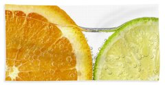 Orange And Lime Slices In Water Beach Towel by Elena Elisseeva