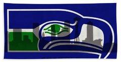 Seattle Seahawks On Seattle Skyline Beach Towel by Dan Sproul
