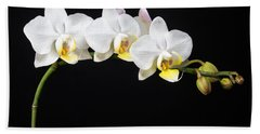 White Orchids Beach Towel by Adam Romanowicz