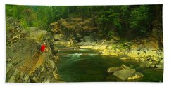 Cliff Over The Yak River Beach Towel by Jeff Swan