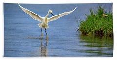 A Snowy Egret Dip-fishing Beach Towel by Rick Berk
