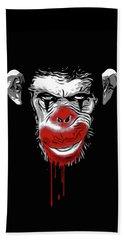 Evil Monkey Clown Beach Towel by Nicklas Gustafsson