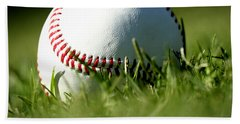 Baseball In Grass Beach Towel by Chris Brannen