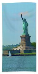 Big Statue, Little Boat Beach Towel by Sandy Taylor