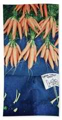 Carrots At The Market Beach Towel by Tom Gowanlock