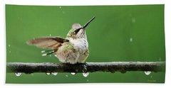 Hummingbird In The Rain Beach Towel by Christina Rollo