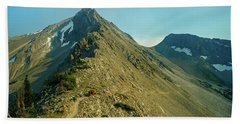 Llama Packer Hiking A Steep Rocky Mountain Peak Trail Beach Sheet by Jerry Voss