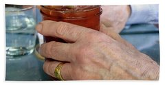 Mans Hand Holding Bloody Mary  Beach Sheet by Beth Wolff