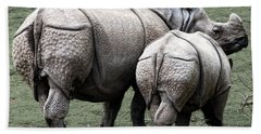 Rhinoceros Mother And Calf In Wild Beach Towel by Daniel Hagerman