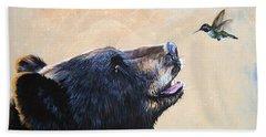 The Bear And The Hummingbird Beach Towel by J W Baker