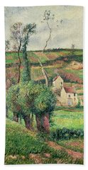The Cabbage Slopes Beach Towel by Camille Pissarro