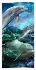 Three Dolphins Beach Sheet by Carol Cavalaris