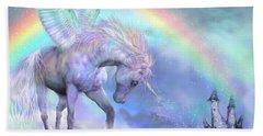 Unicorn Of The Rainbow Beach Towel by Carol Cavalaris