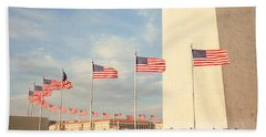United States Flags At The Base Beach Towel by Panoramic Images