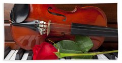 Violin With Rose On Piano Beach Towel by Garry Gay