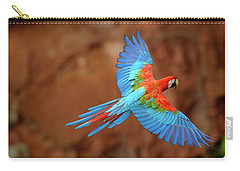 Red And Green Macaw Flying Carry-all Pouch by Pete Oxford