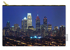 Buildings Lit Up At Night In A City Carry-all Pouch by Panoramic Images