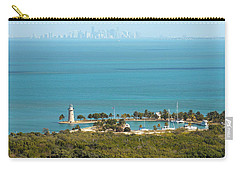 Boca Chita Lighthouse And Miami Skyline Carry-all Pouch by Georgia Fowler