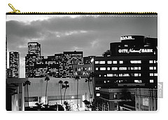 Building Lit Up At Night In A City Carry-all Pouch by Panoramic Images