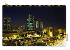 Buildings In A City Lit Up At Night Carry-all Pouch by Panoramic Images