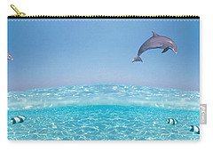 Dolphins Leaping In Air Carry-all Pouch by Panoramic Images