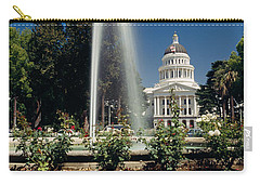 Fountain In A Garden In Front Carry-all Pouch by Panoramic Images