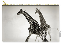 Giraffes Fleeing Carry-all Pouch by Johan Swanepoel