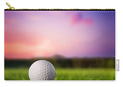 Golf Ball On Tee At Sunset Carry-all Pouch by Michal Bednarek