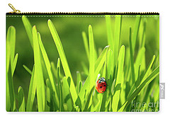 Ladybug In Grass Carry-all Pouch by Carlos Caetano