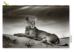 Lioness On Desert Dune Carry-all Pouch by Johan Swanepoel