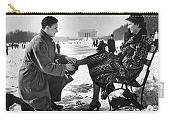 Man Lends A Helping Hand To Put On Skates Carry-all Pouch by Underwood Archives