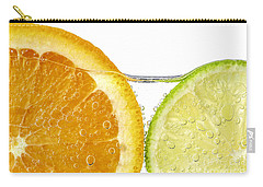 Orange And Lime Slices In Water Carry-all Pouch by Elena Elisseeva