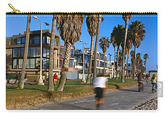 People Riding Bicycles Near A Beach Carry-all Pouch by Panoramic Images