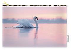 Serenity   Mute Swan At Sunset Carry-all Pouch by Roeselien Raimond