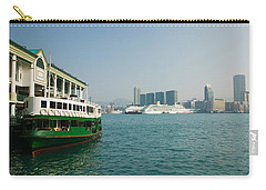 Star Ferry On A Pier With Buildings Carry-all Pouch by Panoramic Images