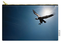 Vulture Flying In Front Of The Sun Carry-all Pouch by Johan Swanepoel