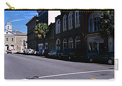 Buildings On Both Sides Of A Road Carry-all Pouch by Panoramic Images