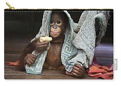 Orangutan 2yr Old Infant Holding Banana Carry-all Pouch by Suzi Eszterhas