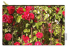 Red Roses In Summertime Carry-all Pouch by Arletta Cwalina