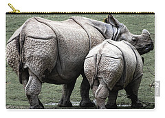 Rhinoceros Mother And Calf In Wild Carry-all Pouch by Daniel Hagerman
