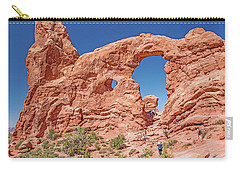 Carry-all Pouch featuring the photograph Tourists On Sandstone Arch Formation, Arches National Park by A Gurmankin